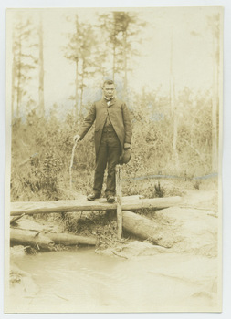 Booker T. Washington on log bridge