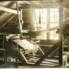 weaving_a_rag_carpet_on_a_loom_in_the_garrett_west_stockbridge_mass.jpg