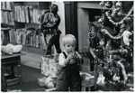 jones_library_kid_and_christmas_tree.jpg