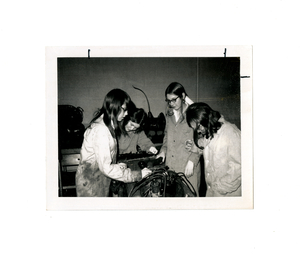 amherst_record_collection_undated_four_girls_in_auto_shop.jpg